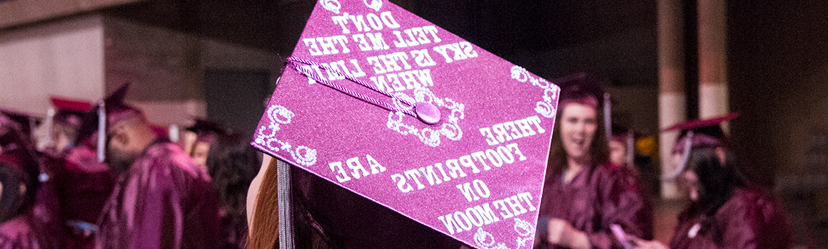 Graduate hat that says