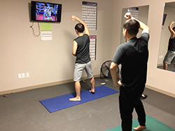 students exercising in residence hall fitness room